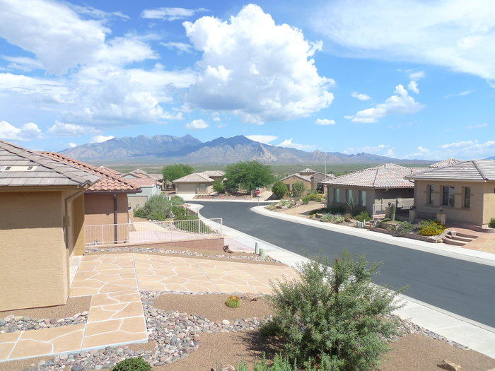 Pleasant neighbourhood in Green Valley with mountains in the distance.