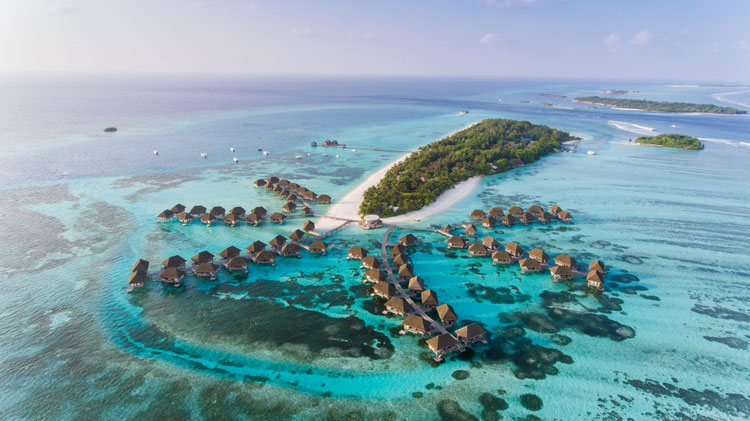 A stunning shot of the many islands making up the Maldives as the ideal romantic destination